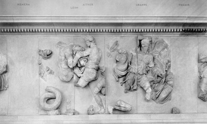 Statue remains, among them the god Aither fighting a lion-like abomination.